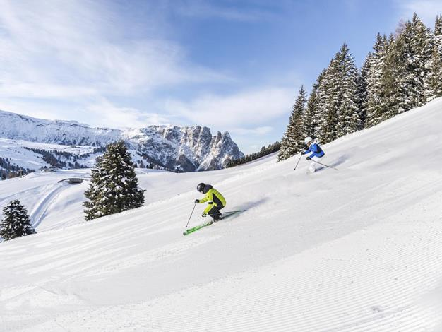 Skiing holiday on the Seiser Alm with panoramic view of the Dolomites
