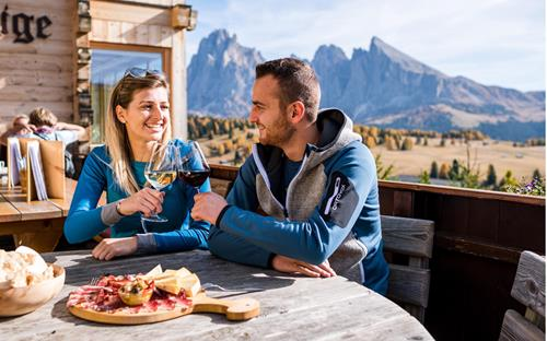 Pleasure and culinary in one of our huts on the Seiser Alm with breathtaking scenery