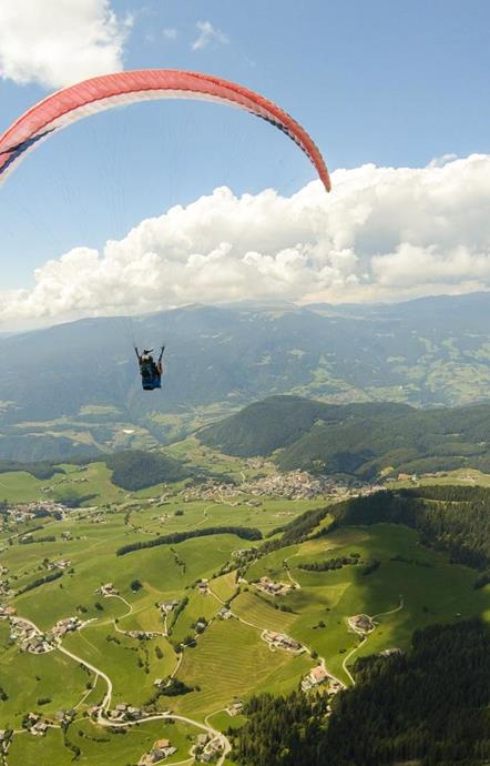 Paragliding with a view of the Alpe di Siusi & the western Dolomites
