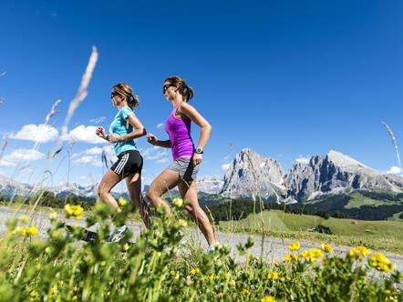 Jogging in the Running Park Seiser Alm in the heart of the Dolomites