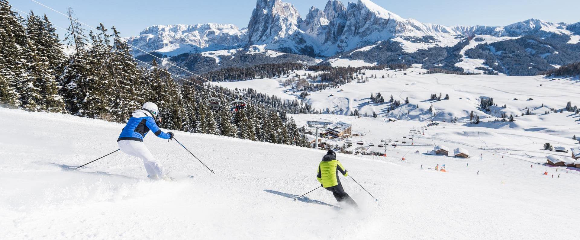 Winter vacation: skiing on the Seiser Alm in the Dolomites