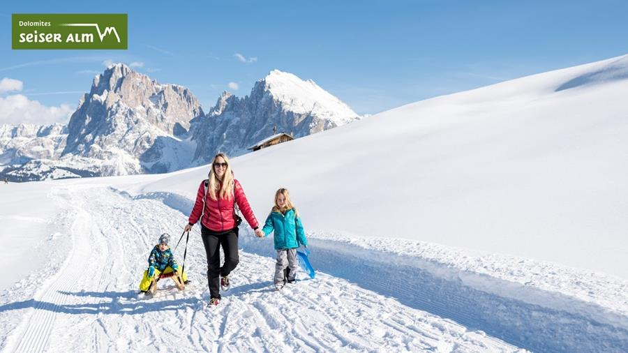 Tobogganing and sledding on the Seiser Alm in the Dolomites
