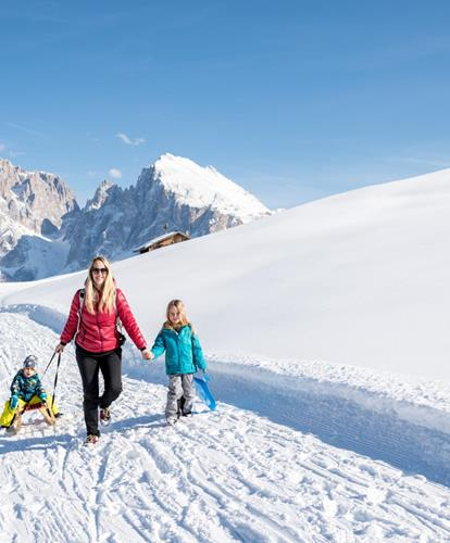Sledding on the largest high alpine pasture in Europe the Seiser Alm in the Dolomites